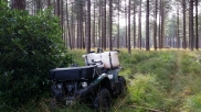 Our quad bike with powered spraying rig accessing rough ground