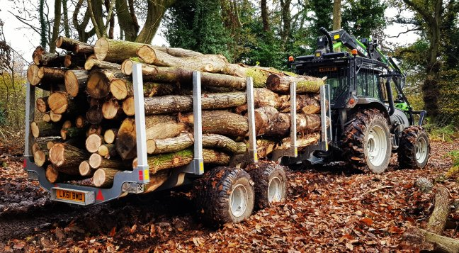 Valtra forestry tractor with roof mounted crane and botex timber trailer