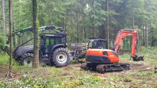 Valtra forestry tractor with 'treedig' forestry excavator .jpg