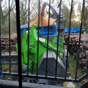 Heizohack chipper creating biomass woodchip